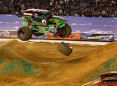 Grave Digger loses a tire in midair during Monster Jam (San Diego Shooter) Tags: sandiego gravedigger monstertruck monstertrucks monsterjam sandiegomonsterjam2009 thepinnaclehof tphofweek36