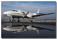 Metroliner (Ross Forsyth - tigerfastimagery) Tags: canon scotland edinburgh aviation mirrorimage propeller reflexions unitedstatesnavy swearingen metroliner edinburghairport c26