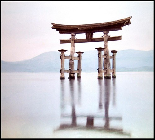 THE OLD TORII IN THE SEA AT MIYAJIMA FLOATS ABOVE ITS REFLECTION in OLD JAPAN