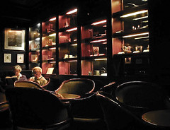let's sit down for a quiet read (axiepics) Tags: cruise light southamerica dark reading couple ship chairs library books read cruiseship cape capehorn norwegiansun copyrightalexskellyallrightsreserved