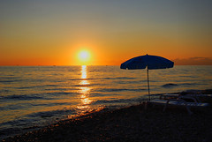 Izola (Sareni) Tags: sunset sea summer sky sun beach water colors clouds reflections evening boat nikon waves ship july vivid sunshade explore more slovenia sail slovenija 2009 horizont isola jadran twop izola d60 sunchairs nikond60 jadranskomore sareni