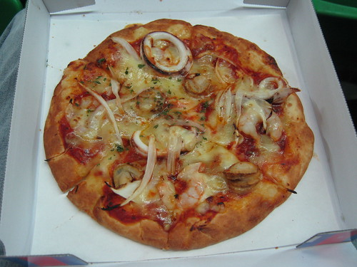 The pizza in question. Yes, those are shrimp, calamari, and other miscellaneous seafoods.