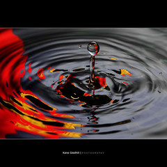 Fire and Ice ([ Kane ]) Tags: light colour ice wet water fire waterdrop ripple flash drop explore kane frontpage strobe gledhill 50d 430exii kanegledhill wwwhumanhabitscomau kanegledhillphotography