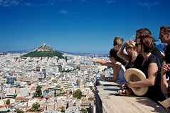 Titanic... (_skynet) Tags: city travel blue vacation sky people holiday hat contrast buildings europe downtown ship republic finger hill crowd group hellas athens humour greece backpacking traveling titanic pointing acropolis athena athina hella hellenic flickrsbest