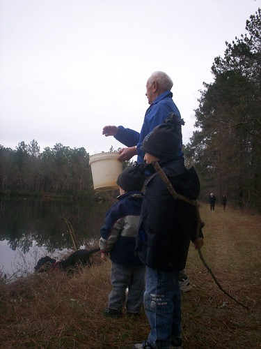 grandad and the boys feeding fish