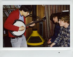 Party-time-banjo-fun. (Claire Marie Vogel) Tags: camera new boy people music playing film boys musicians analog vintage polaroid photography photo claire 60s sitting fuji image watching wide picture banjo charlie bands ty photograph 200 roland sit 70s instant fujifilm seated segall vogel mikal instax cronin moonheart moothart cosio