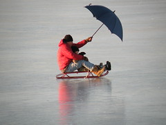 Weeeeeeeeeeeeeeeeeeeeeeee! (Sister72) Tags: cold ice umbrella river ride wind nj monmouthcounty sled 2009 navesink