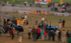 Tractor Racing - Panning Shot (Ajit Pal Singh) Tags: two horses india tractor game history sports sport festival youth rural speed photo dance high construction war colorful village bullock action folk bare events traditional religion culture mini games event riding winner vehicle warrior effort tug olympics sikh cart agriculture punjab popular 2009 schedule kila sponsor bravery agricultural daredevil stunt bhangra deliver courage gallop daring gallary implements ludhiana compete galloping quila footed grewal kabbadi raipur giddha kilaraipur mywinners tractive qilaraipur