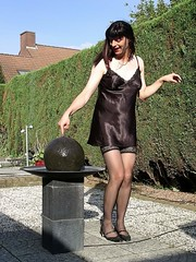 Playing girl (Paula Satijn) Tags: black stockings garden shiny legs tgirl tranny transvestite slip satin silky nightdress nightie