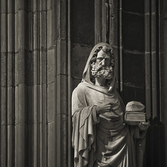 Statue outside cologne cathedral (manganite) Tags: old male men art church monochrome wall sepia architecture digital buildings germany square de geotagged iso200 nikon europe tl cologne statues kln monotone historic cropped d200 nikkor dslr toned sculptures lightroom klnerdom colognecathedral f63 northrhinewestphalia nikond200 18200mmf3556 manganite 1640sec repost1 date:year=2008 date:day=25 format:orientation=square format:ratio=11 1640secatf63 date:month=mai geo:lon=6956827 geo:lat=50941214