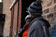 Conversation (Lauren Barkume) Tags: africa portrait people woman man building brick african conversation mtm artisan lesotho crafter maseru aidtoartisans maserutapestriesandmats laurenbarkume