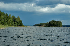 Behind the islands (terminal orbit) Tags: summer vacation white lake holiday clouds finland boat cottage lakedistrict august rowing daytime explorers exploration boattrip 2009 kerimki summercottage saimaa rowingboat savo puruvesi hlv itsavo