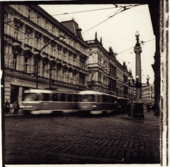 Trams near the Rycni Bridge, Prague (Alfie | Japanorama) Tags: city travel blur 6x6 film architecture mediumformat print landscape europe czech prague transport tram motionblur squareformat czechrepublic ilfordxp2 trams tramlines rolleicord splittoned seleniumtoned filmedges