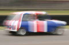 mini motion (Curtis Bartlett) Tags: uk blue red england white motion classic cars canon vintage austin eos moving mini racing fab4 goodwoodrevival 400d