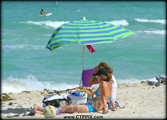 A Day @ Miami Beach (CTPPIX.com) Tags: travel vacation people woman usa seagulls beach girl hat birds closeup america umbrella canon ball 350d xt sand women pretty legs florida zoom miami body surfer gulls relaxing ct surfing basebal
