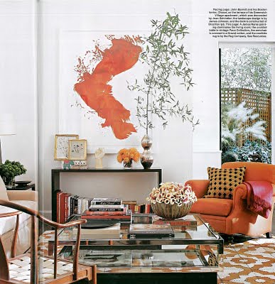 Orange decor: Modern art + vintage cocktail table, from Elle Decor