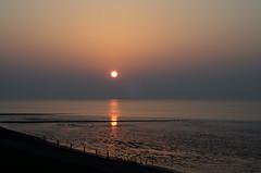 Sunset at the Waddensea (paladijn) Tags: sunset sea waddenzee dike levee waddensea