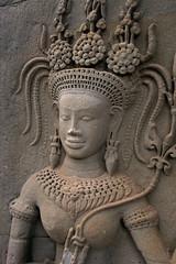 Intricate wall carving of Apsara dancer at Angkor Wat