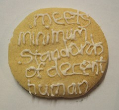 A cookie.  In icing it reads Meets Minimum Standards of Decent Human