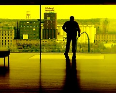 the sentinel (Darwin Bell) Tags: silhouette yellow person minneapolis stranger lookout explore pillsbury guthrietheater pillsburyflour artlibre superaplus aplusphoto karmanominated colourartaward thechallengefactory