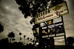 Reseda Welcomes You (dogwelder) Tags: california sky sign june clouds keys palmtrees electronics stoplight zurbulon6 2009 batteries cellphones reseda watchband shermanway citylimits zurbulon hubofthewestvalley
