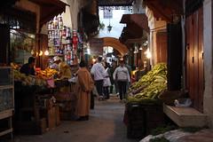 The Moroccan Souk Scene (MykReeve) Tags: street light people vegetables sign shop fruit vegetable arabic morocco fez shops souk medina fes geo:lat=34062855 geo:lon=4973347