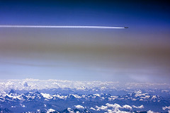 Airplane over the Alps (Greg Bajor) Tags: mountains alps clouds plane airplane flying aircraft flight over jet trails boeing contrails 747 vapour elal gregbajor