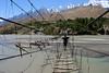 Crossing the Hussaini Bridge (rovinglight) Tags: bridge pakistan highway crossing karakoram northern passu hussaini lpdamaged
