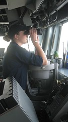 Ensign Sarah Atwell watches through binoculars, USS Mahan (wrightrkuk) Tags: binoculars piracy usnavy somalia unitedstatesnavy seafarers gulfofaden ussmahan watchkeeping sarahatwell ctf151 coalitiontaskforce151 antipiracyoperations womenseafarers