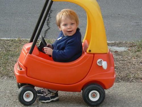 Happy little guy in his car car