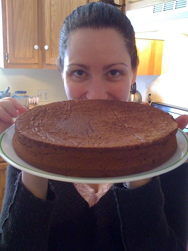 Val presenting chocolate flourless cake