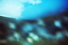 Woosh... over my head (mikeasaurus) Tags: blue newzealand summer reflections lomo lca xpro surf waves underwater kodak crossprocessing nz blau elitechrome 100asa wellen expiredfilm karekare waitakeres distortions unterwasser c41 karekarebeach expired2005 inthesurf march2009 krabunderwaterhousing nzholiday2009