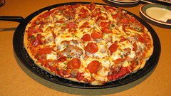 A delicious thin crust Chicago style pizza topped with sausage, Pepperoni, and Green Peppers.