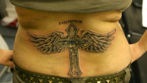 cross with wings and flowers cover up tattoo