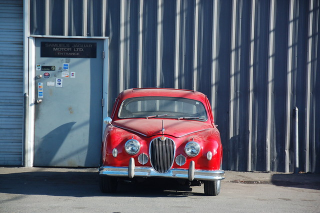 Red Jaguar Mark 1 Parked in front of the garage by Chris Devers