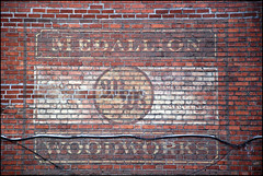 MW ( CHRISTIAN ) Tags: sign wall montral bricks signage medallion mur publicit carvings briques ghostsign woodworks mtlguessed modlings gwim