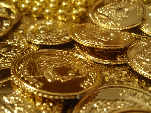 close up of a pile of gold dobloons