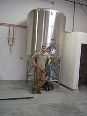 Joel Vandenbrink of Two Beers Brewing poses next to his shiny new fermenter.