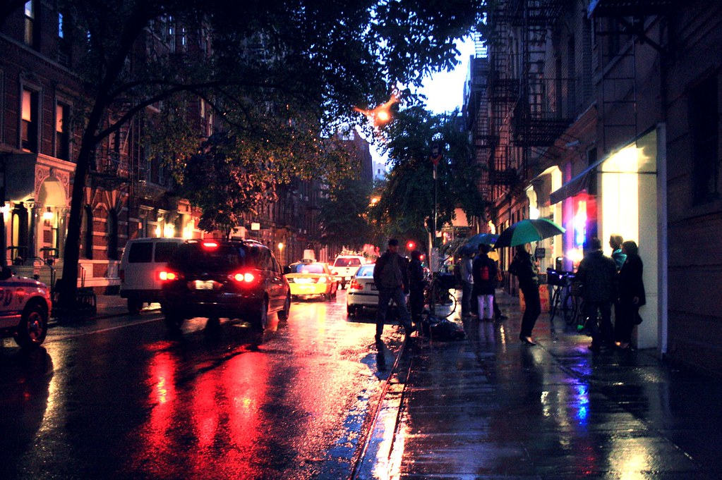 Bleecker Street at night in the rain.