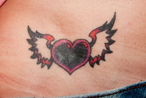 Cross Tattoo Thorns. People get Heart Tattoo in