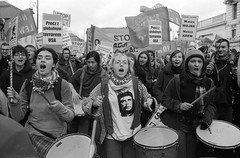 Warsaw, 20.03.2004 (Teofil  Rewers) Tags: road street city girls people blackandwhite bw music white news black film girl musicians analog canon silver drums eos photo persian riot war photos drum military georgebush iraq crowd flock banner protest poland tshirt mob scream warsaw raft che banners anti riots slogan citizen loud canoneos guevara protester iraqi ernesto protesters slogans citizens demostration saddamhussein manifestation shout demonstrant throng occupation foma rioter manifest globalism antiglobalism rioters demonstrants kodakxtol flickr:user=teofilrewers image:content=demonstration
