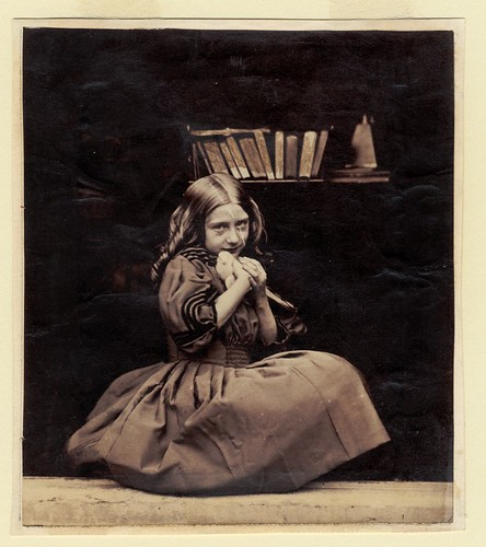 Girl with dove by George Eastman House.