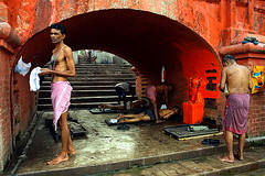 untitled | Kolkata (arnabchat) Tags: street morning red people india men bath streetphotography massage hanuman kolkata bengal preparation calcutta bangla westbengal ghaat canon400d babughat streetphotographyincolor