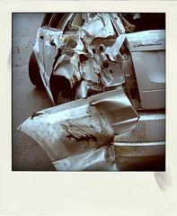 silver crash (BoringPostcards) Tags: auto car metal polaroid crash wreck damaged twisted destroyed totaled
