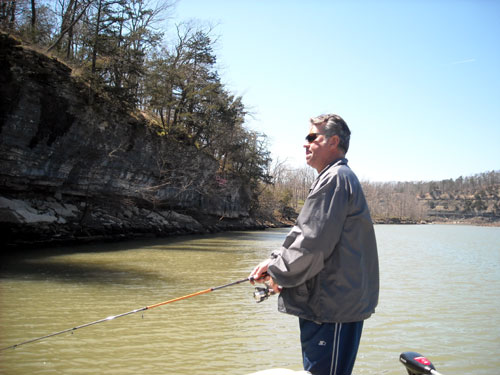 My husband casting a line.