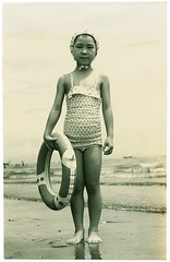 Child in bathing costume, found (Lil [Kristen Elsby]) Tags: old fashionspast portrait blackandwhite bw beach girl japan sepia vintage print found japanese seaside asia child topv5555 oldphoto vernacular swimsuit bathingsuit swimwear earlyphotography eastasia bathingcap bathingcostume  swimmingring