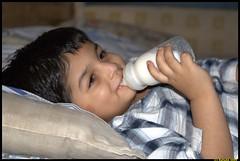 Laying on bed ([ RAFIQ ]) Tags: wallpaper portrait cute beautiful smile night pose children happy photo milk kid bottle bed child background feeder pillow mattress bedsheet abdullah rafiq rafiqsa