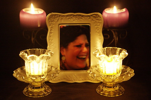 Four Candles for the Queen of the Universe