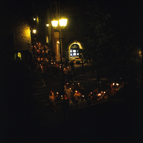 Image of people carrying candles to the bonfire