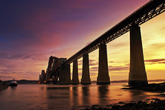 The forth bridge at sunrise (Stuart Stevenson) Tags: longexposure bridge summer sky seascape sunrise canon outdoors scotland edinburgh canon300d naturallight stuart forth f22 colourful soe forthbridge southqueensferry 18mm seatide hawespier stuartstevenson abittiredtonight ©stuartstevenson